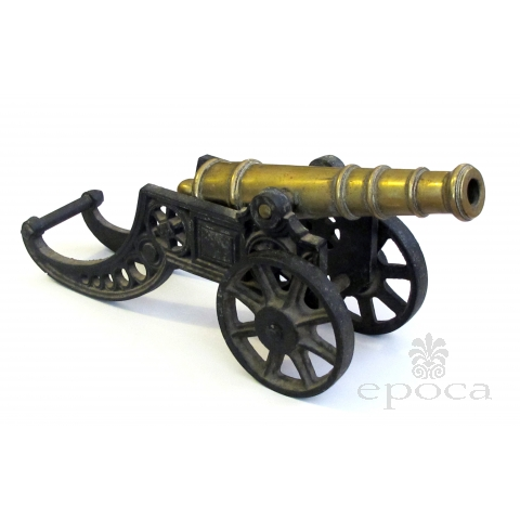 a finely rendered english victorian brass ornamental cannon on cast iron carriage