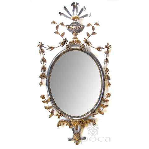 a chic and good quality italian 1960's silver and gold gilt metal oval mirror by with trophy crest and floral and foliate swags; attributed to palladio, italy