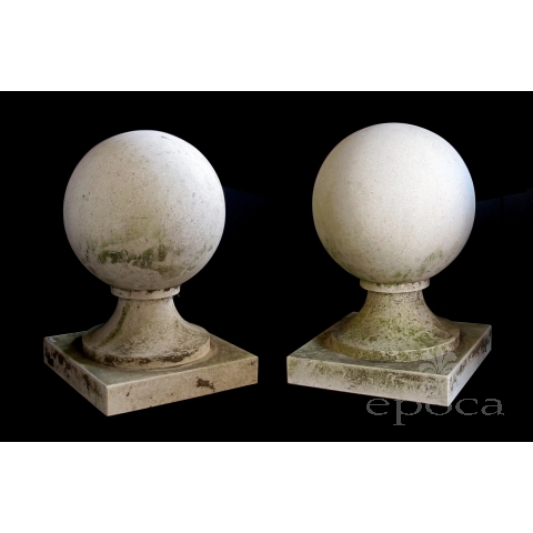 a stately pair of french neoclassical style carved limestone orb-form garden elements